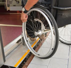 getting a wheelchair over a threshold